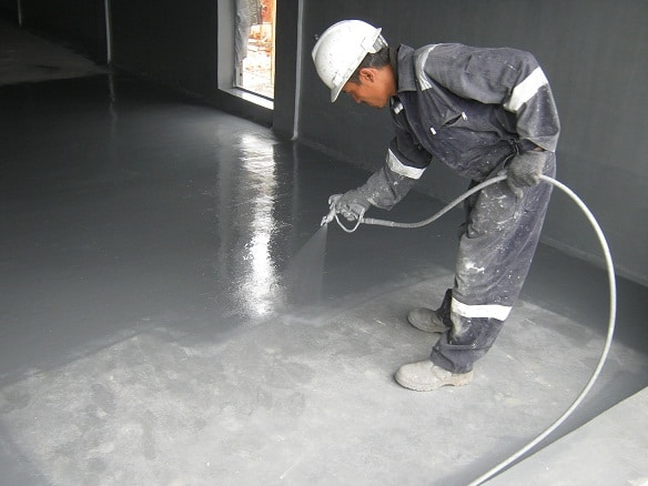 man-spraying-floor